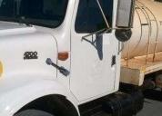 Tracto camion con pipa  en excelente estado