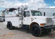 Grua tipo titan terex para electricista con equipo diesel