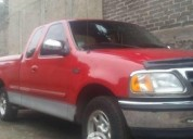 camioneta ford color rojo gasolina