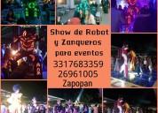 Show de robot de luces y zanqueros arlequines guad
